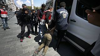 Turkish police officers arrest protesters