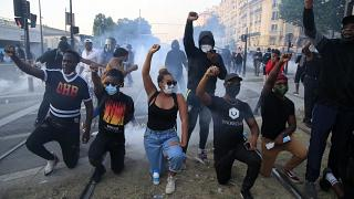 Protesters react during a demonstration Tuesday, June 2, 2020 in Paris.