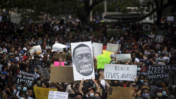 Thousands of members of the community gathered to mourn the death of George Floyd during a march across downtown Houston, Texas on Tuesday, June 2, 2020.