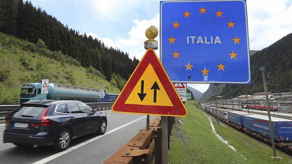 A car from Germany drives from Austrian to Italy at the Brenner Pass boarder crossing