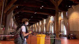 Belgian students study inside UNESCO World Heritage sites during coronavirus pandemic, May 2020.