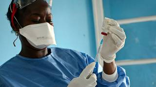 A healthcare worker from the WHO prepares vaccines to give to front line aid workers in the Congo