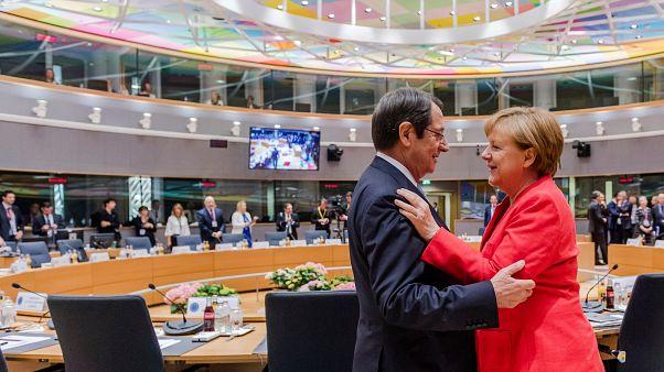 German Chancellor Angela Merkel, right, speaks with Cypriot President Nicos Anastasiades