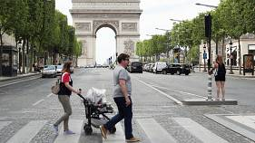 People stroll on the Champs Elysees avenue in Paris