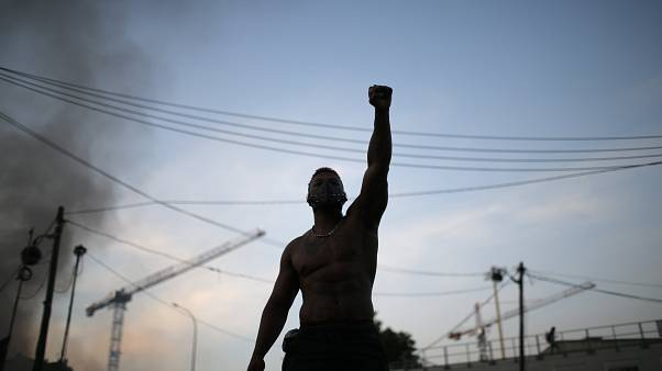 A protester raises his fist during a demonstration Tuesday, June 2, 2020 in Paris.