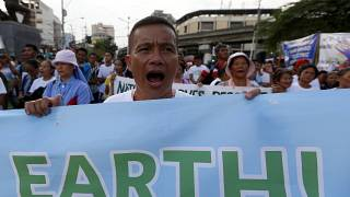 Environmental activists shout slogans as they conclude their caravan from the southern Philippines to mark the global celebration of World Environment Day on  June 5, 2020.