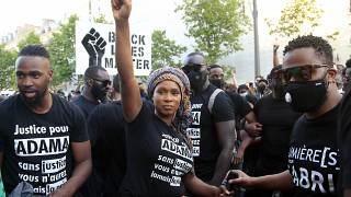 Assa Traore, sister of Adama Traore, raises her fist during a demonstration in Paris.