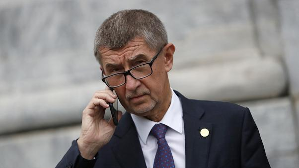 Czech Republic's Prime Minister Andrej Babis talks on the phone as he leaves after a meeting in Beja, Portugal, Saturday, Feb. 1, 2020