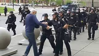 A Buffalo police officer shoves a man who walked up to police Thursday, June 4, 2020, in Buffalo, N.Y.