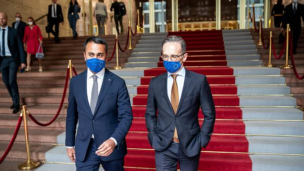 German Foreign Minister Heiko Maas, right, and his Italian counterpart Luigi Di Maio wear face masks