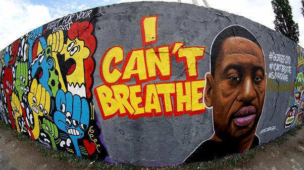 A graffiti by artist 'EME Freethinker' that expresses support of U.S. protests over the death of George Floyd in the public park 'Mauerpark' in Berlin, Germany