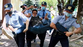 Kazakh police detain a demonstrator during a demonstration called by political opposition groups, Almaty, Kazakhstan, June 6, 2020.
