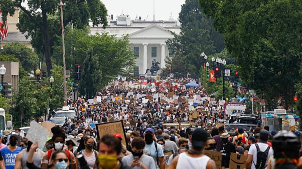 Demonstrators protest Saturday, June 6, 2020, near the White House in Washington, over the death of George Floyd