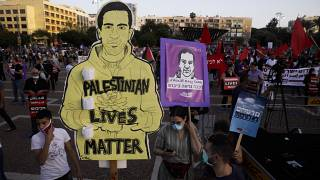 Protesters attenda rally against Israel plans to annex parts of the West Bank, in Tel Aviv, Israel, Saturday, June 6, 2020.
