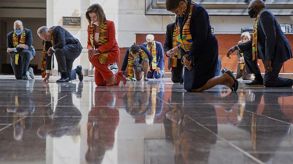 House Speaker Nancy Pelosi kneels with other US Democrats to pay tribute to George Floyd