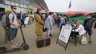 People, wearing face masks to protect against coronavirus, give their signatures in support of potential presidential candidates in the presidential elections in Minsk