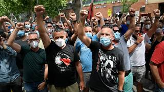 People in Spain protest the closure on the Nissan plant in Barcelona.