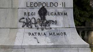 A statue of Belgium's King Leopold II is defaced with the words 'shame' prior to a Black Lives Matter protest rally in Brussels, Sunday, June 7, 2020.