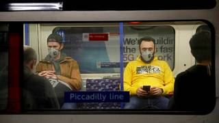 Passengers wearing face masks travel on a Piccadilly Line underground train in London, March 20, 2020 (file).