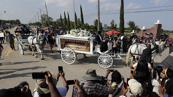 George Floyd's funeral procession arrives at Houston Memorial Gardens cemetery, Tuesday, June 9, 2020, in Pearland, Texas.