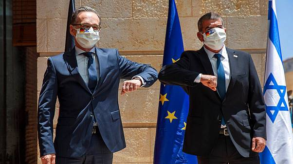 Israeli Foreign Minister Gabi Ashkenazi, right, welcomes his German counterpart Heiko Maas with an elbow bump prior to their meeting in Jerusalem, Wednesday, June 10, 2020