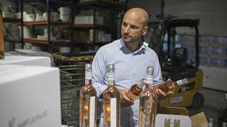 Sebastien Latz, director of French wine producer MDCV, inspects bottles of rosé at Chateau des Bertrands vineyard in Le Cannet-des-Maures, in the Provence region, Oct 2019