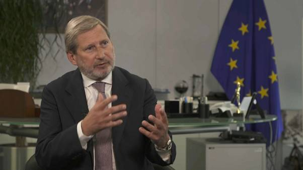 Commissioner Johannes Hahn talking to Euronews