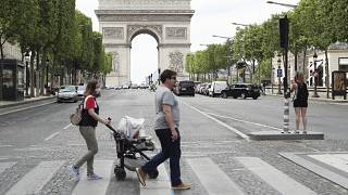 People stroll on the Champs Elysees avenue in Paris, Wednesday, June 3, 2020.