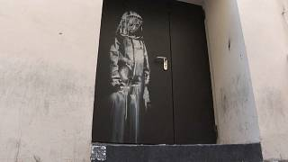 Banksy's artwork on a fire exit of the Bataclan concert hall in Paris - File, June 2018