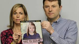 FILE - In this May 2, 2012 file photo, Kate and Gerry McCann hold a poster depicting an age progression computer generated image of their daughter Madeleine.
