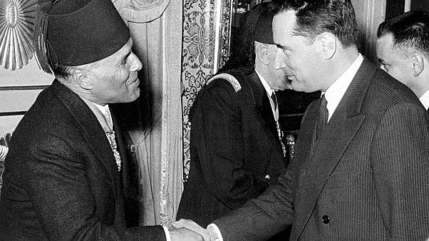 French Justice Minister Francois Mitterrand shakes hands with Tunisian Prime Minister Habib Bourguiba during the Independence celebration in Tunis 20 May 1956