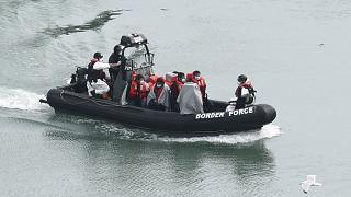 A group of people, thought to be migrants are transported on a Border Force vessel, in Dover, England, Monday, April 27, 2020