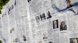 In this March 18, 2020 file photo, local newspaper Eco di Bergamo features several pages of obituaries in its March 17, 2020 edition, in Mediglia, Italy.