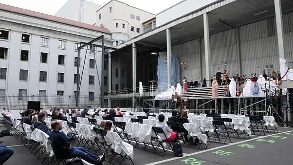 "Wagner's ""Das Rheingold"" performed on a makeshift stage in a car park in the German capital."