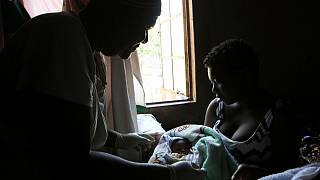A baby is born in the poor surburb of Mbare in Harare, Zimbabwe, Saturday, Nov. 16, 2019.