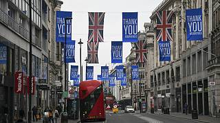 Union flags and support messages are seen in the shopping street, Oxford Street, ahead of the reopening of the non-essential businesses on Monday, June 15
