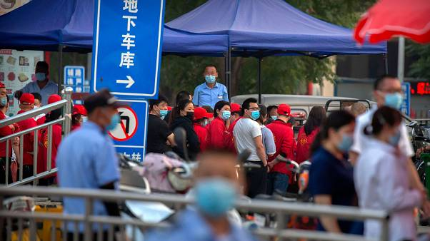 Parts of Beijing go under lockdown as fresh coronavirus clusters appear