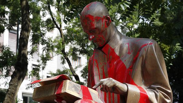 Red paint is seen on a statue of late Italian journalist Indro Montanelli, in Milan, northern Italy, Sunday, June 14, 2020