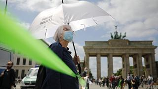 A protestor attends the 'This is solidarity' demonstration of the  Indivisible movement, in Berlin, on June 14, 2020.