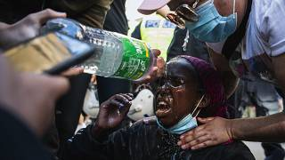 A protester reacts after being pepper sprayed by police during a Black Lives Matter demonstration in Stockholm, Sweden
