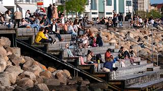 People enjoying the warm evening weather in Malmo, Sweden, Tuesday May 26, 2020.