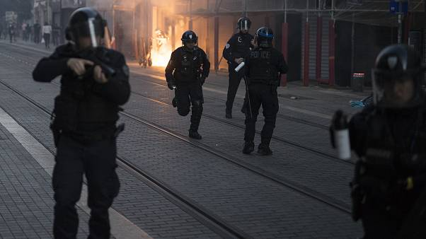 Police advance on protesters during a march against police brutality and racism in Marseille, France, Saturday, June 13, 2020.