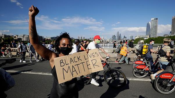 A member of Black Lives Matter movement during a protest in central London, Saturday, June 13, 2020.