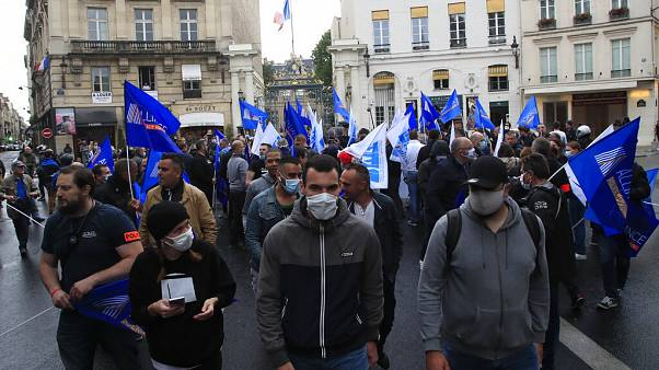 In this June 12, 2020, file photo, French police unionists demonstrate in front of the Interior Ministry in Paris.