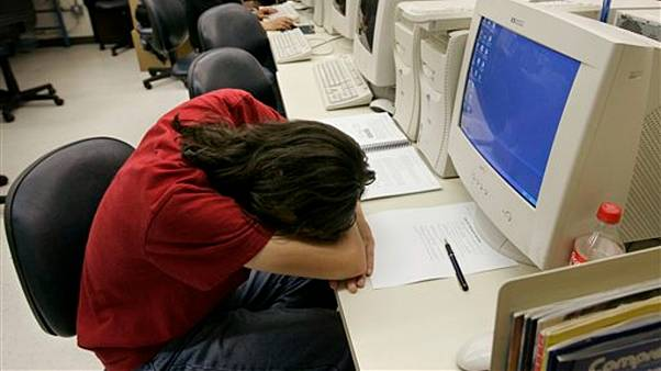 A jobseeker rests during an employment test
