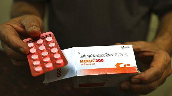 A chemist displays hydroxychloroquine tablets