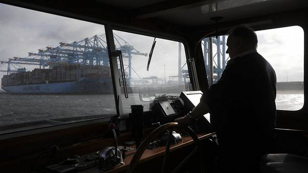 A container ship is unloaded in the harbor of Rotterdam, Netherlands, Tuesday, Sept. 11, 2018