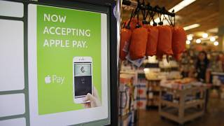 In this photo taken Friday, Oct. 17, 2014, a cash register terminal promotes usage of the new Apple Pay mobile payment system at a Whole Foods store in Cupertino, Calif.