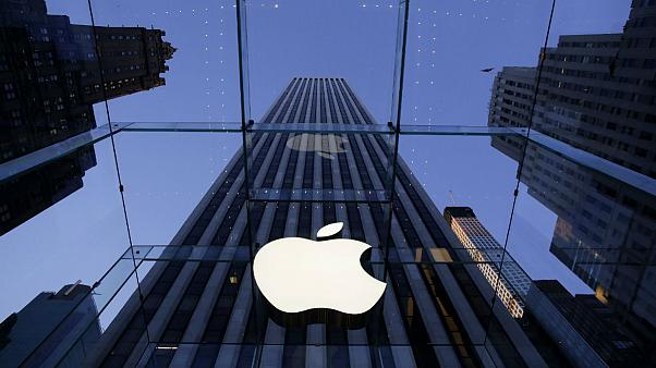 Apple logo hangs in the glass box entrance to the company's Fifth Avenue store in New York