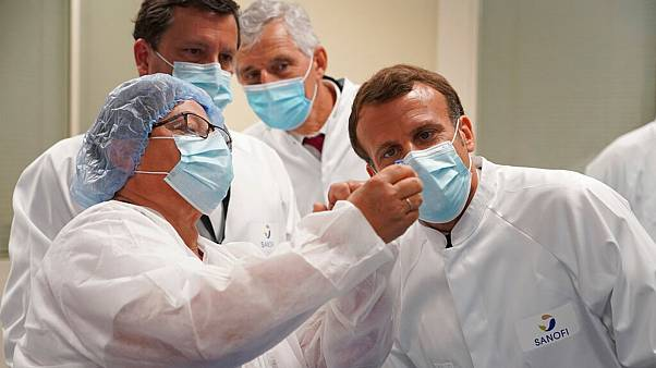 French President Emmanuel Macron visits a vaccine plant of drugmaker Sanofi in Marcy-l'Etoile, near Lyon, France, Tuesday, June 16, 2020.